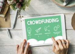A tablet with the word crowdfunding