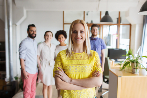 Young woman and her team featured in their creative office
